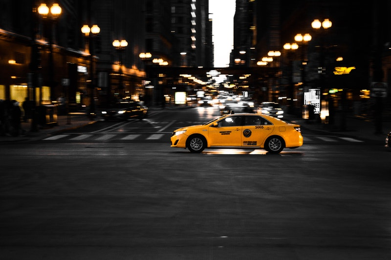 photography-of-yellow-taxi-on-road-1236720